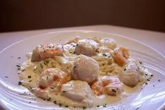 Fresh Shrimp and Scallops  - Sauteed in our homemade white sauce - served over pasta