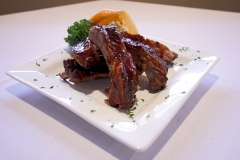 CHIPOTLE BBQ RIB APPETIZER - 1/2 rack of St. Louis style pork ribs- dry rubbed and slow cooked- then glazed with our chipotle bbq sauce and grilled