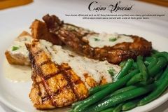 Cajun Special -  Your choice of fish and an 8 oz NY Strip, blackened and grilled, over cheesy grit cakes and topped with a cajun cream sauce, served with a side of fresh green beans.