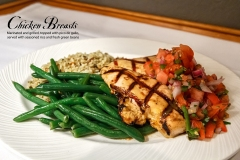 Chicken Breasts - Marinated and grilled, topped with pico de gallo, served with seasoned rice and fresh green beans.