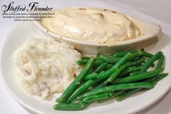 Stuffed Flounder - Jumbo lump crab meat surrounded by fresh filet of  flounder en casserole, broiled and topped with a lobster cream sherry sauce.